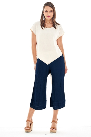 OMG -A wide legged cropped cotton gauze pant with striped applique detail at the hemline.